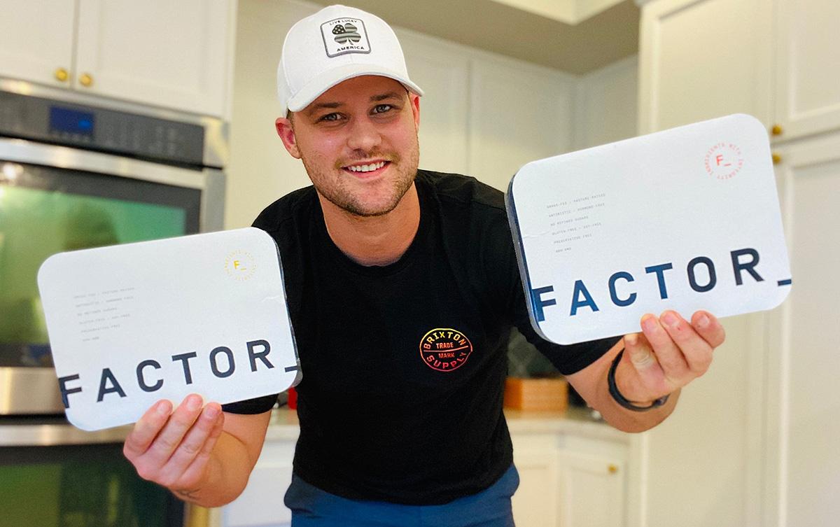 man holding factor meals