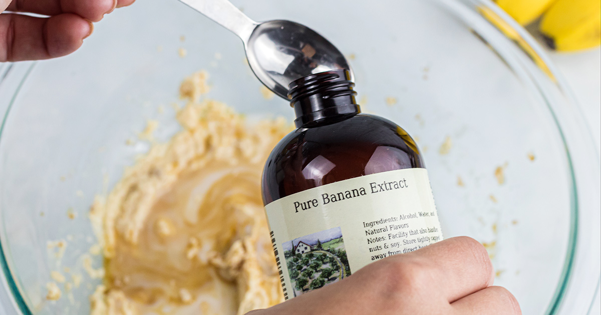 pouring pure banana extract into measuring spoon