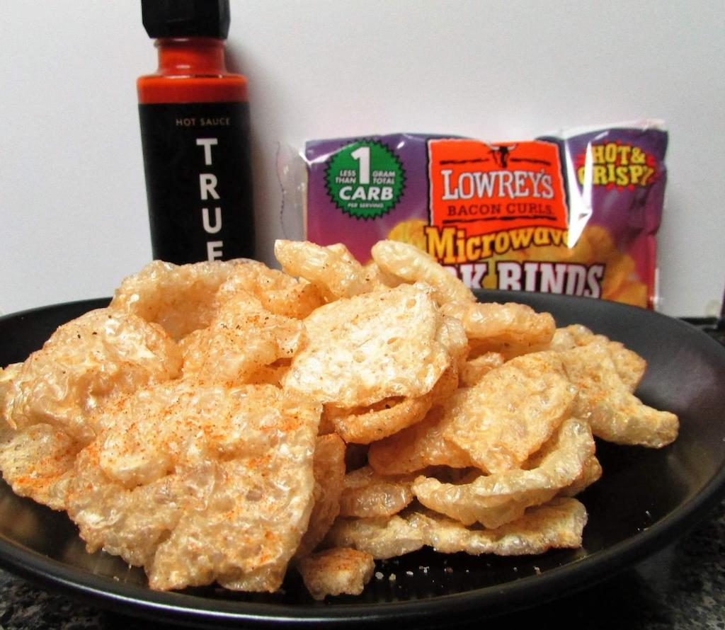 Lowrey's Microwave pork rinds on plate
