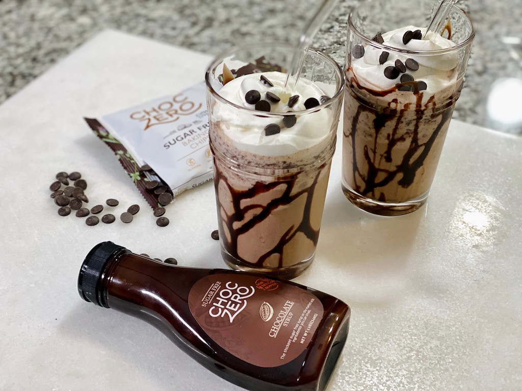 Starbucks inspired keto frapps on counter with ChocZero syrup and chocolate chips