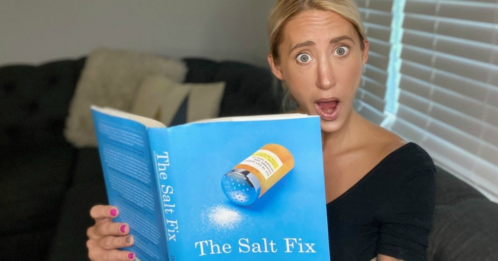 woman reading The Salt Fix book