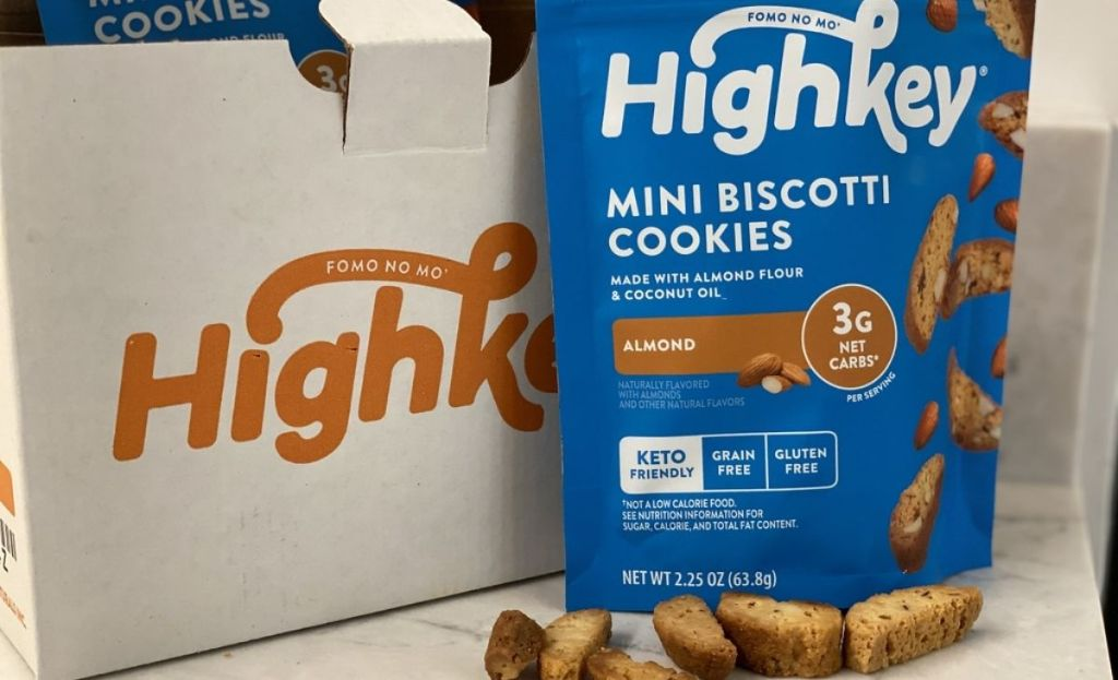 A bag of biscotti cookies next to a few sitting on a counter