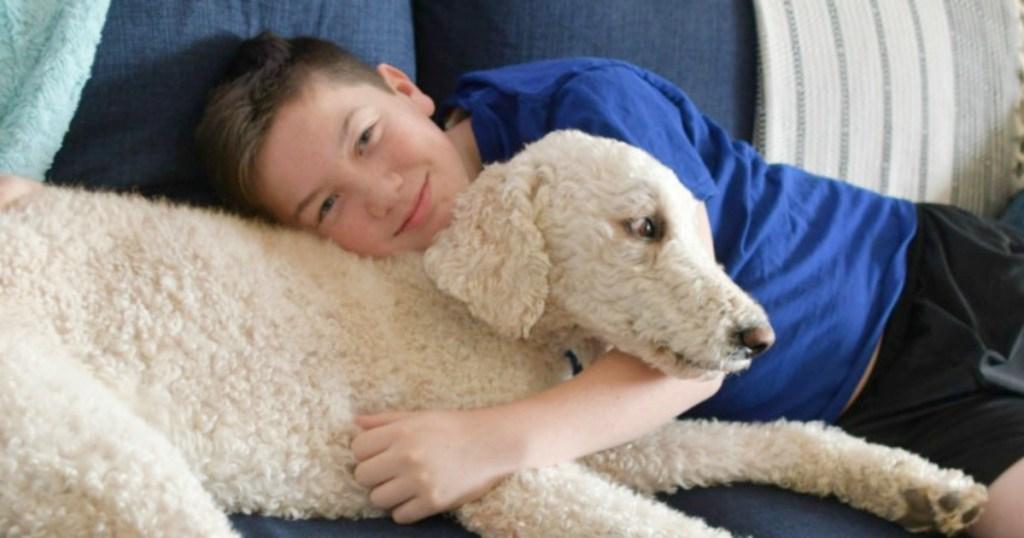 bog snuggling with dog