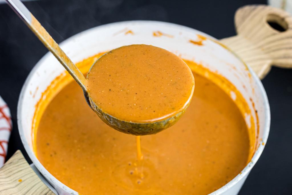 ladling out keto pumpkin soup