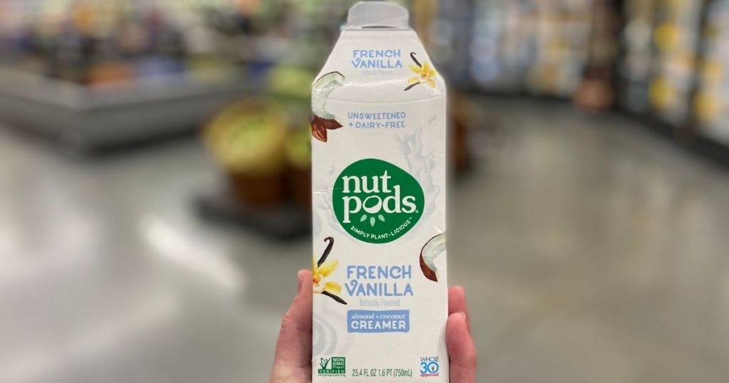 hand holding a Nutpods coffee creamer