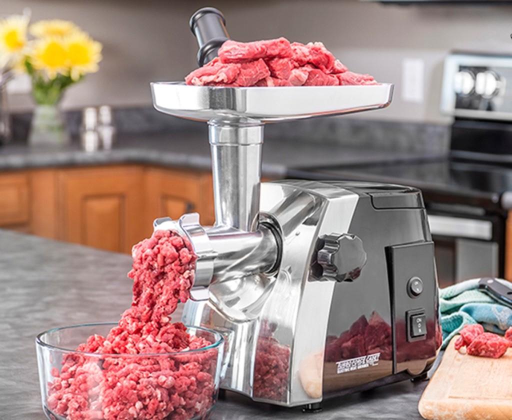 stainless steel meat grinder on countertop