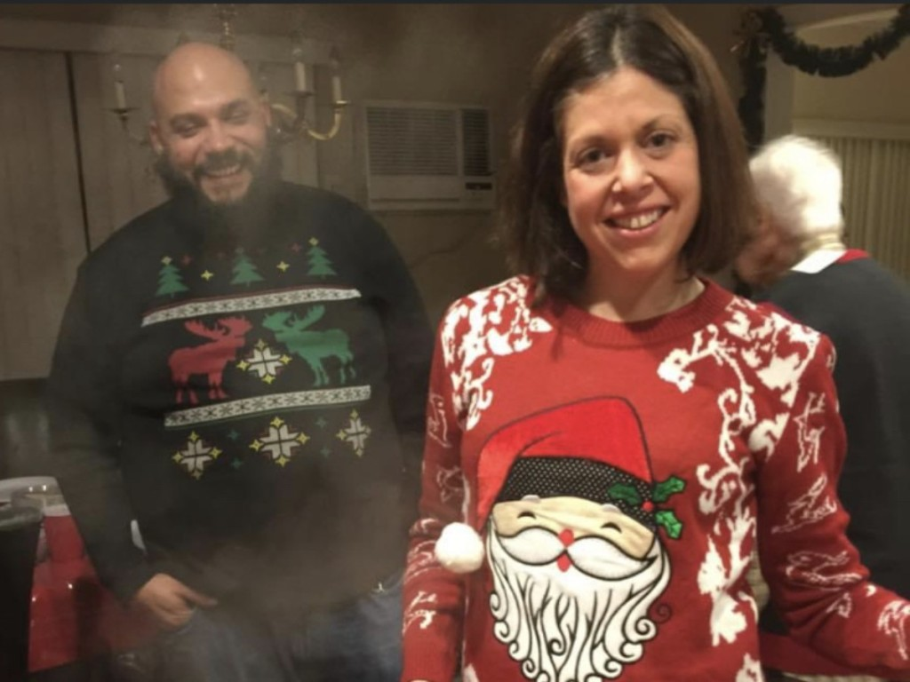 woman wearing Christmas sweater