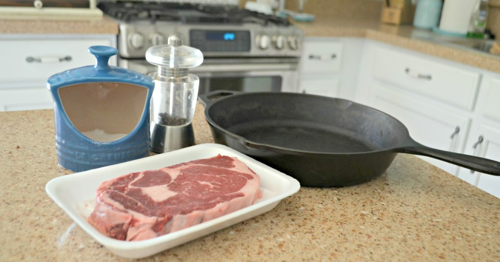 cast iron skillet and steak on the counter