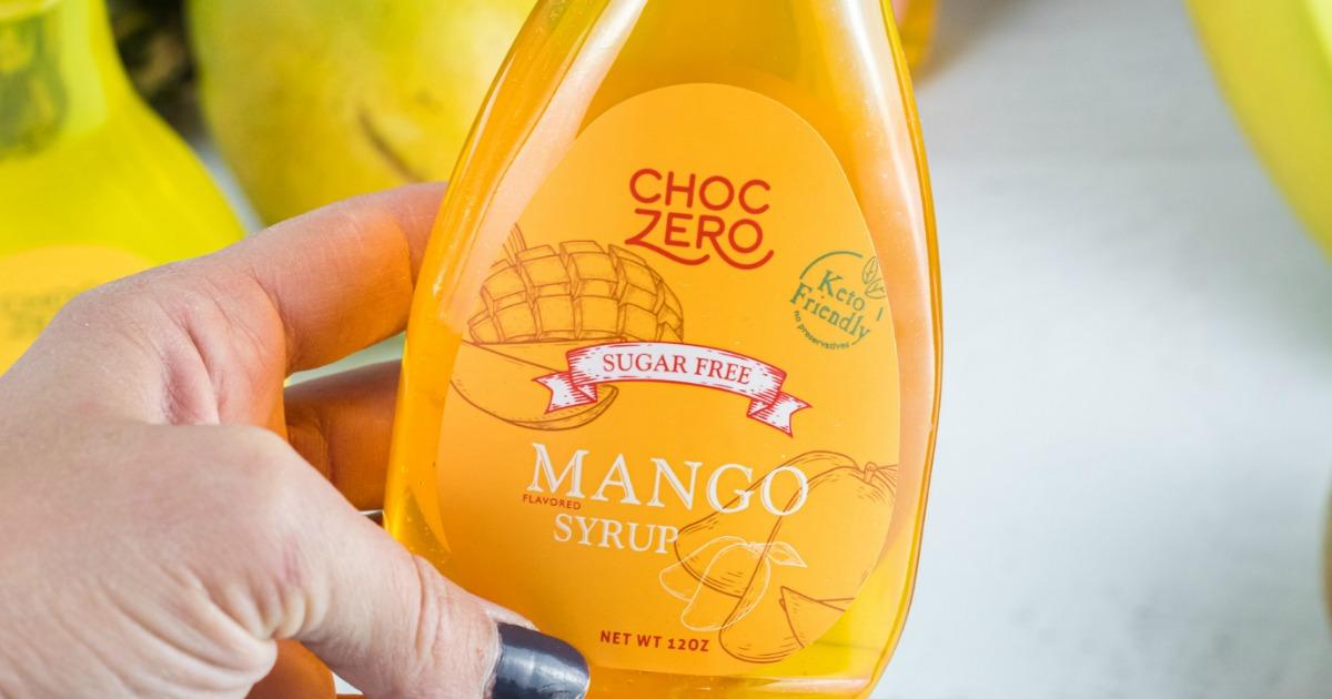 holding ChocZero Mango syrup