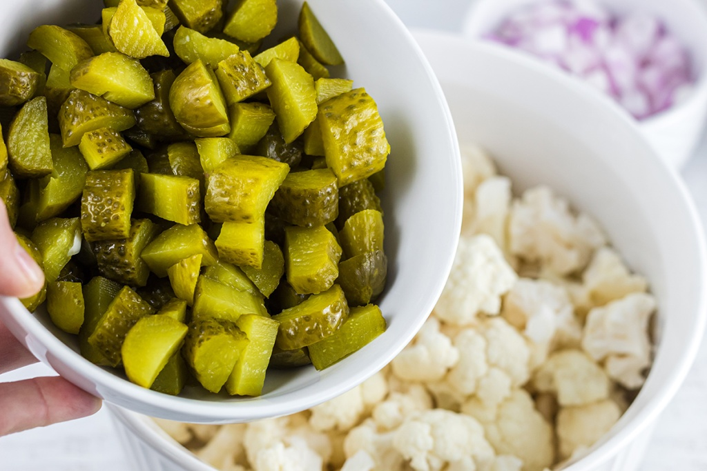 bowl of chopped pickles for keto dill pickle cauliflower salad