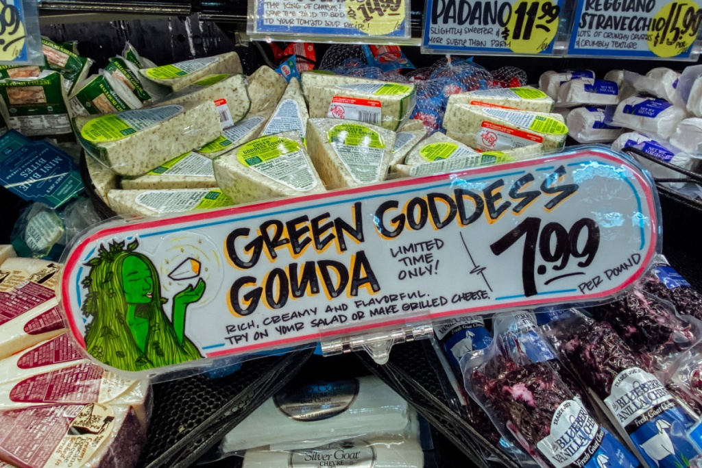 Cheese section of Trader Joe's with gouda cheese