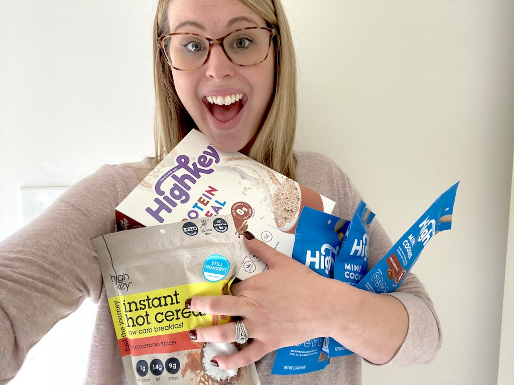 woman holding various types of high key cereal