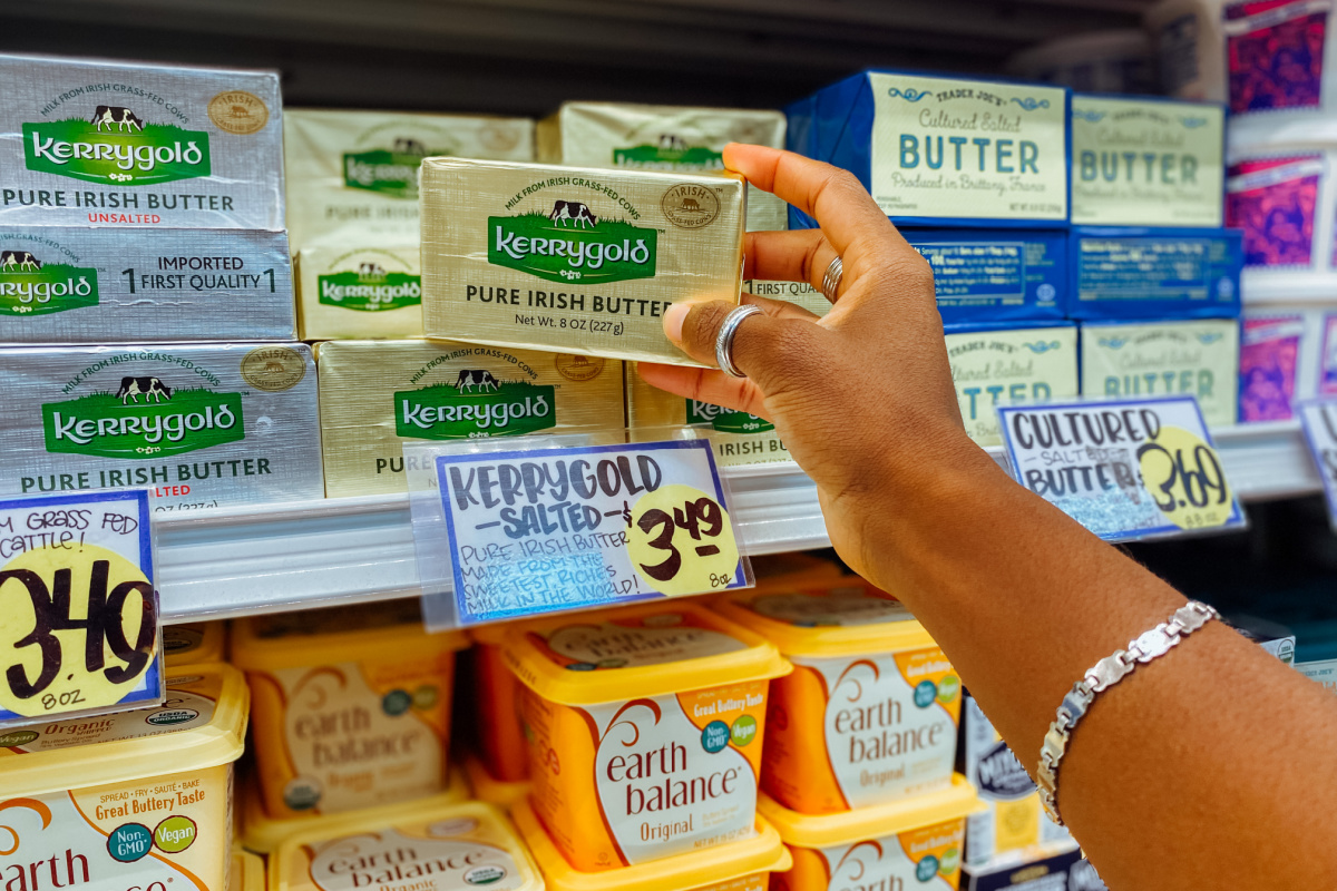Hand holding package of Kerrygold butter