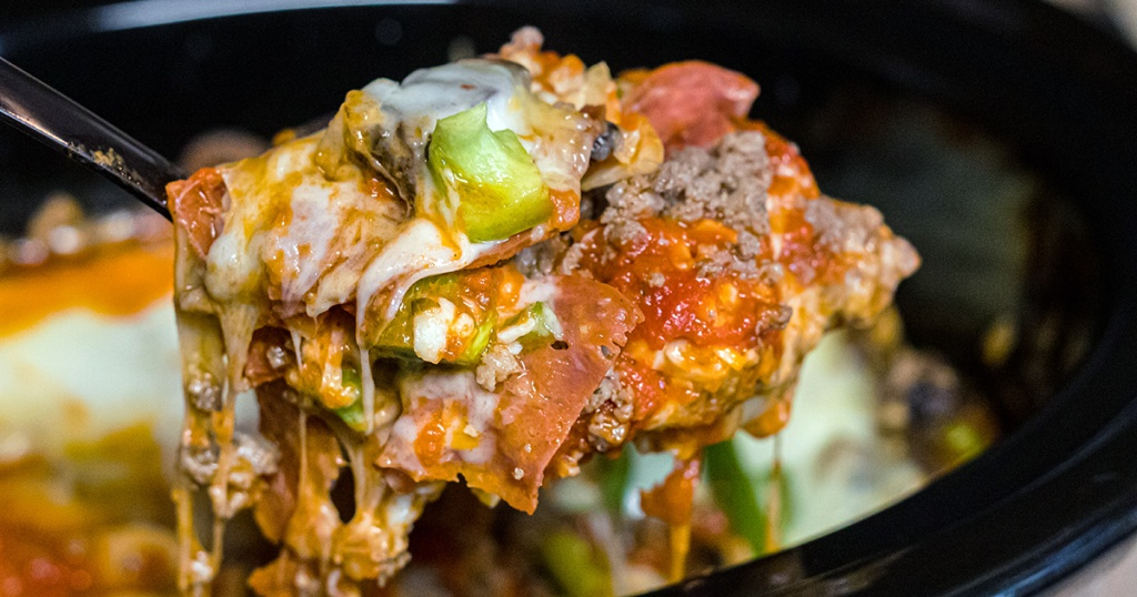 heaping spoonful of keto pizza casserole out of slow cooker
