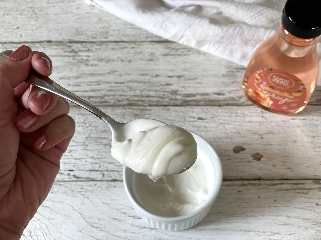 putting ChocZero syrup on full fat keto yogurt