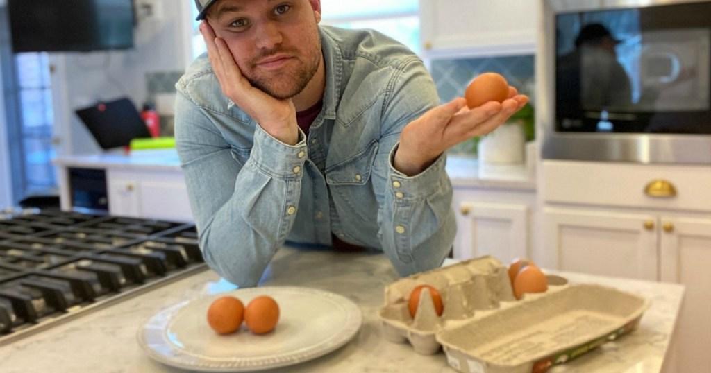man holding egg
