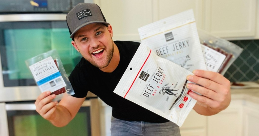 man holding packages of beef jerky