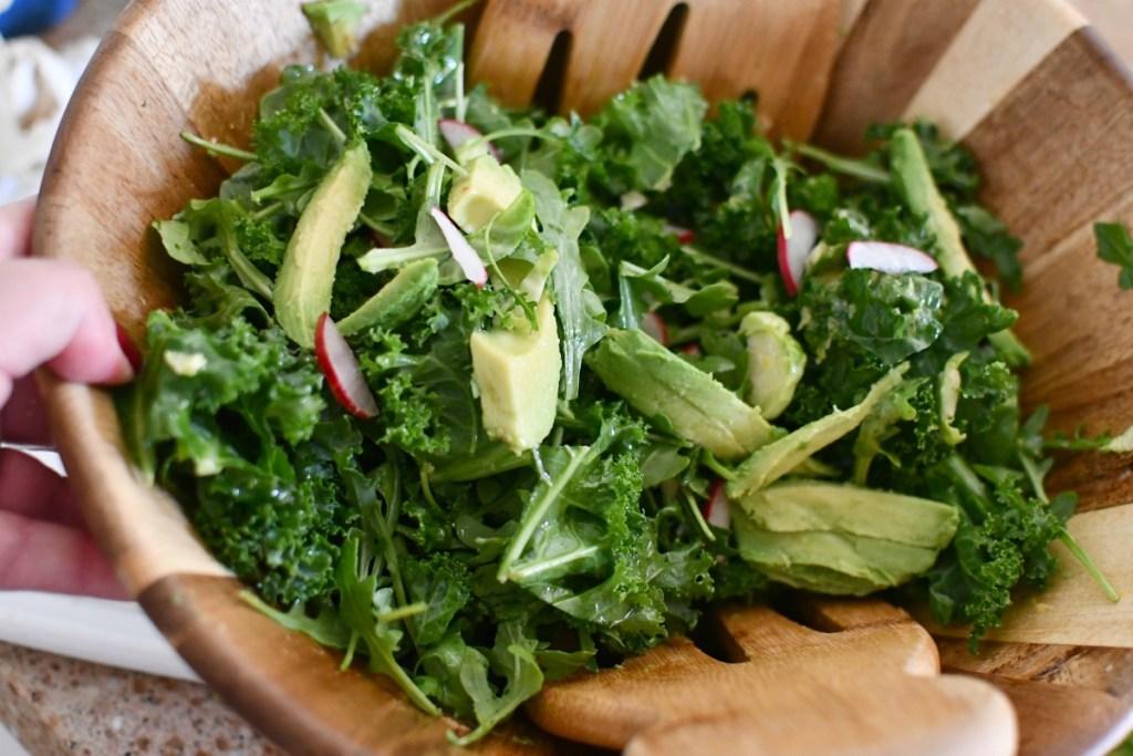 bowl of greens and avocado for keto almond crusted salmon salad