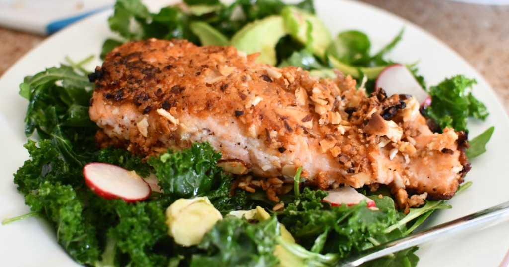 almond crusted salmon on bed of lettuce