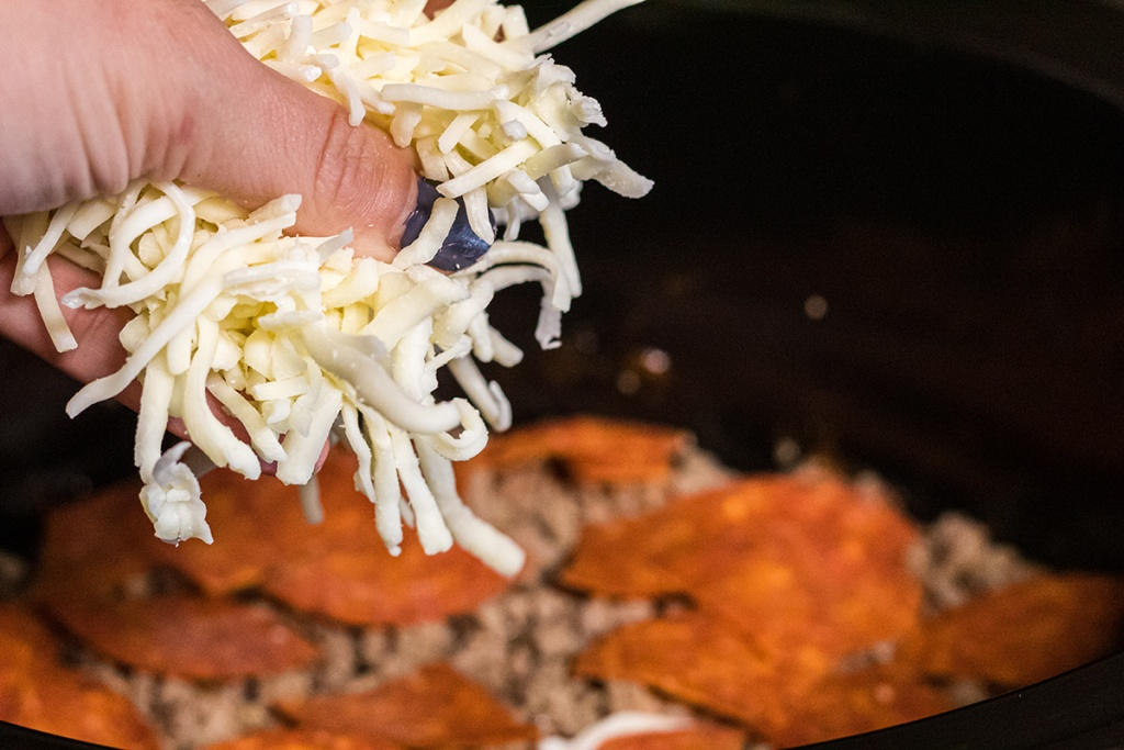 adding shredded mozzarella to crockpot