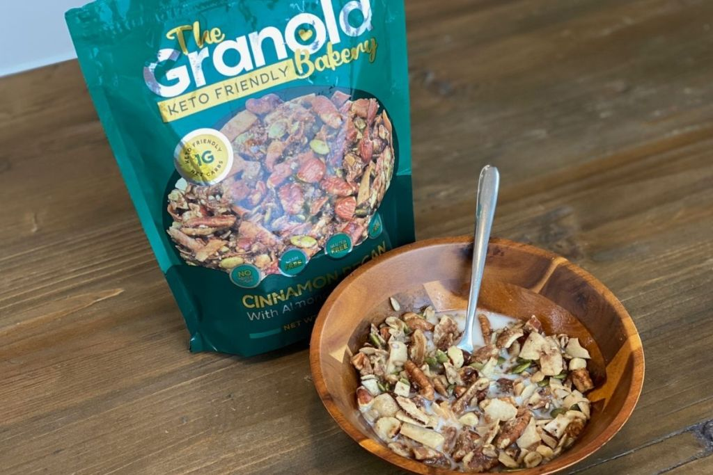 A bag of granola next to a bowl of granola with milk