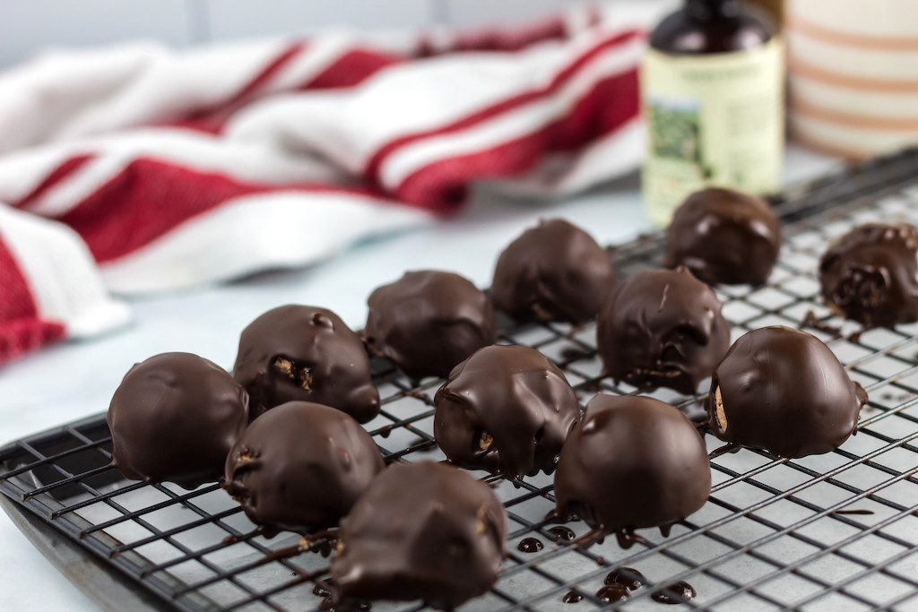 keto chocolate covered cherry fat bombs on cooling rack