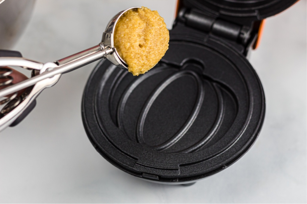 pouring batter into chaffle maker