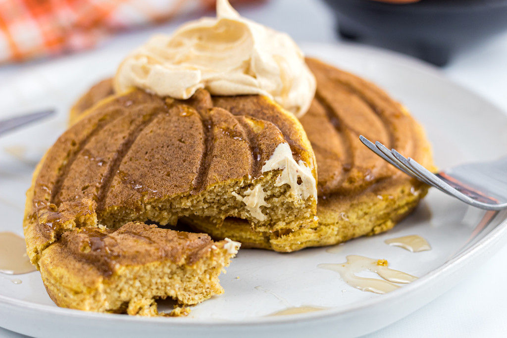 digging into keto pumpkin chaffle with whipped cream