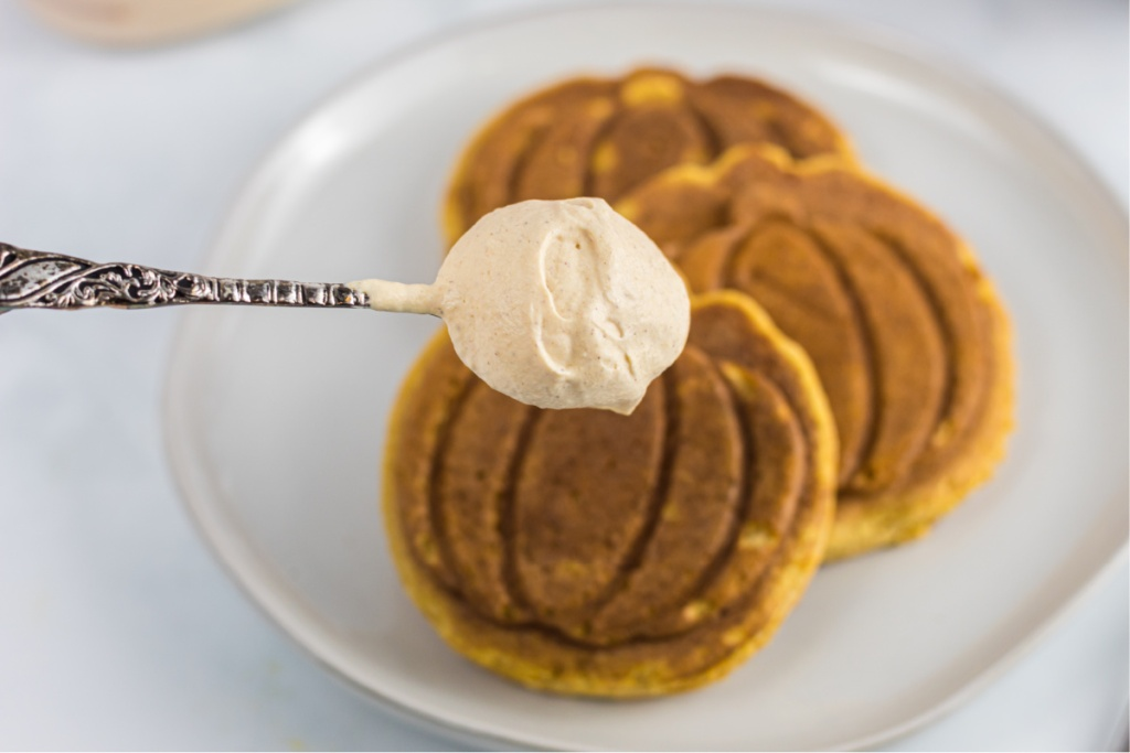 dollop of whipped cream on pumpkin chaffle