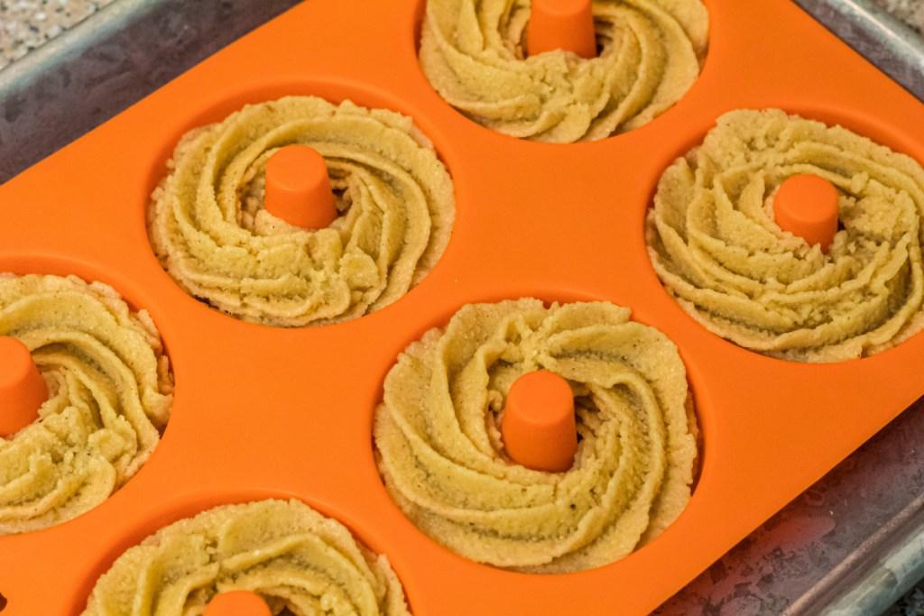 donut batter in donut molds