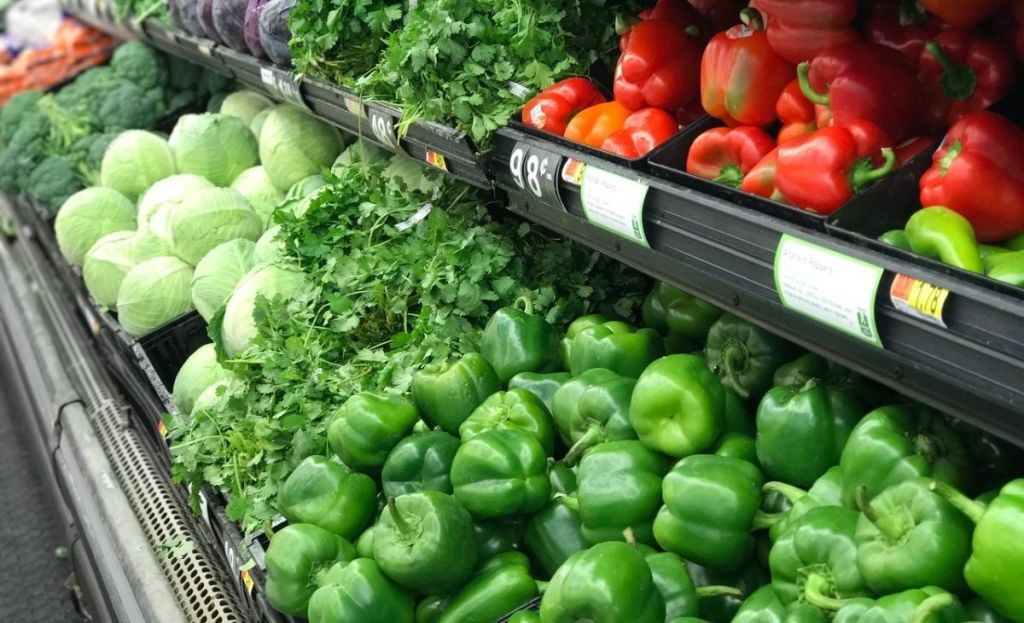 Vegetables in the produce aisle at a grocery store