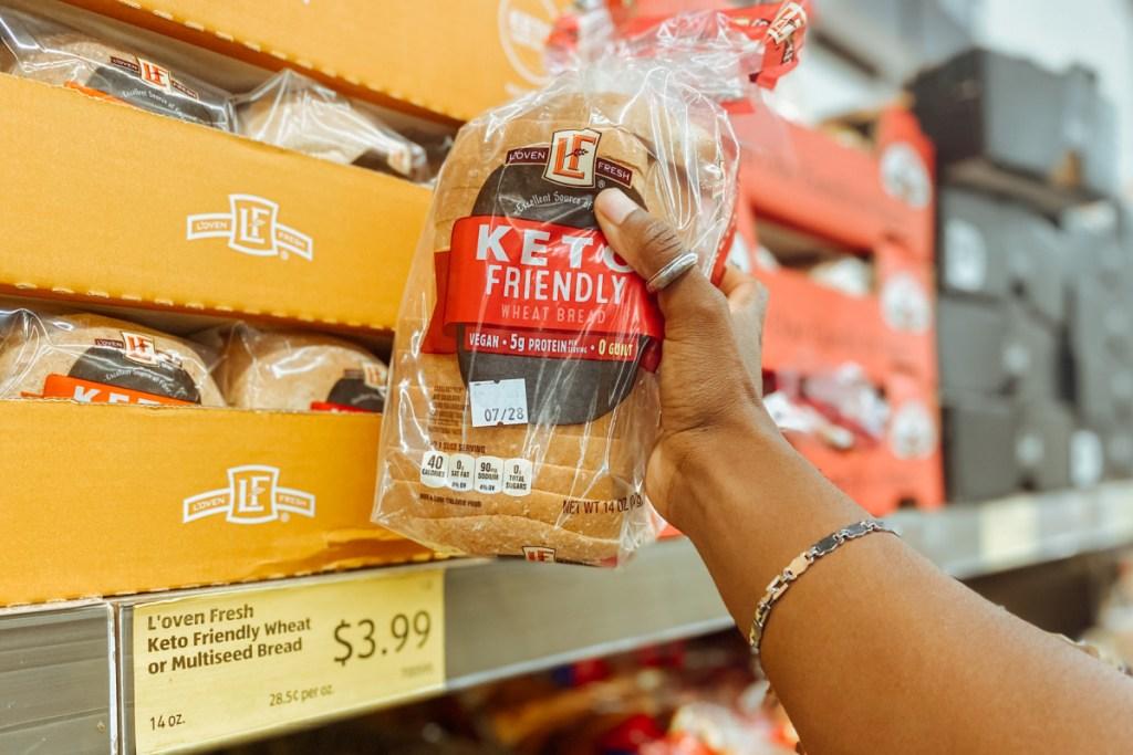 holding aldi bread