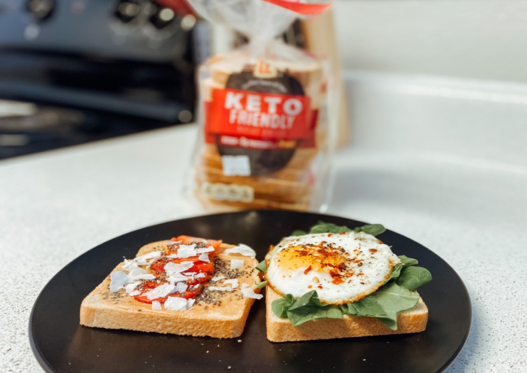 fried egg and strawberries on slices