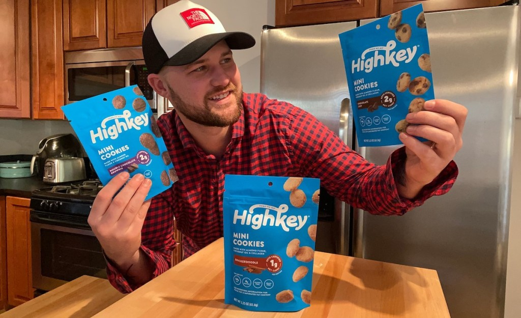 man holding bags of high key cookies