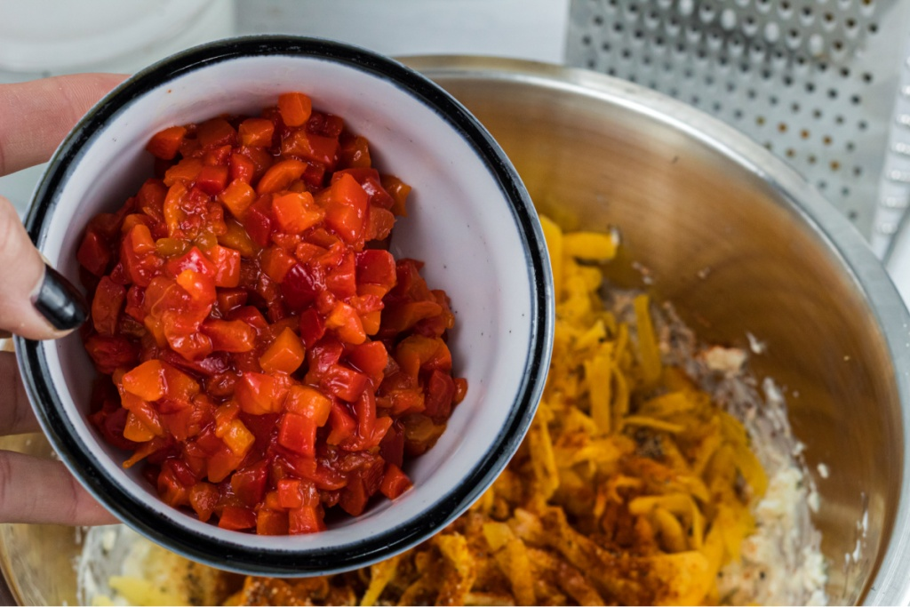 adding pimentos peppers to cheese