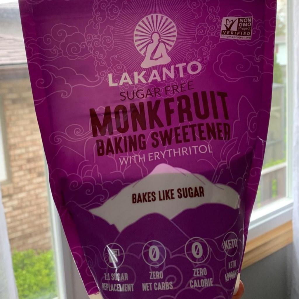 holding bag of monkfruit sweetener