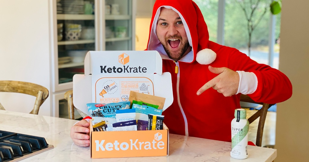 man in a Christmas onesie with a keto krate box