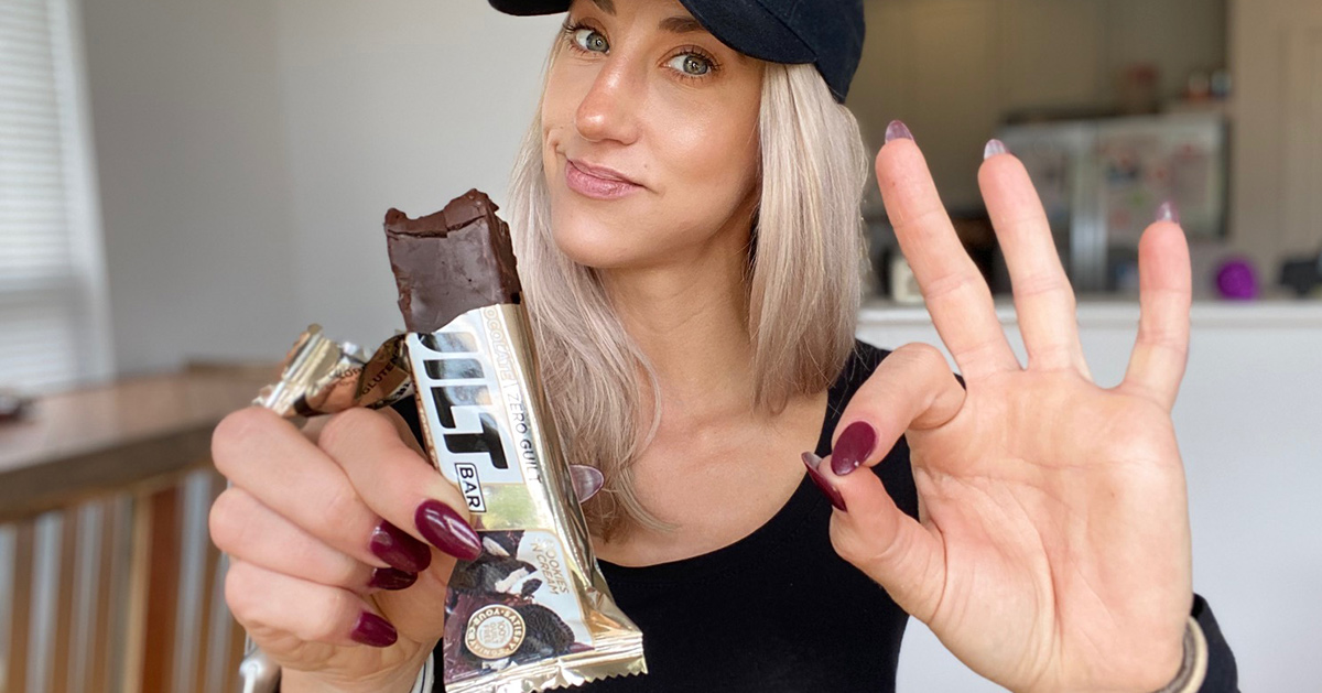 woman with cookies and cream built bar