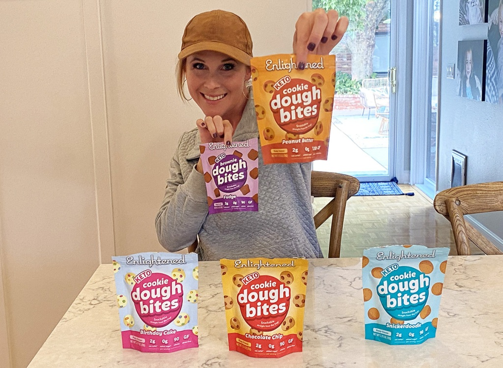 woman holding bags of keto cookie dough bites