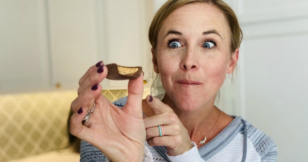 woman holding and pointing at Quest peanut butter cup
