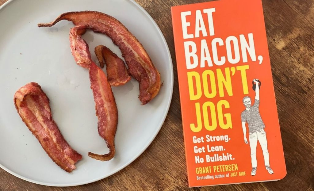 A book next to a plate of bacon