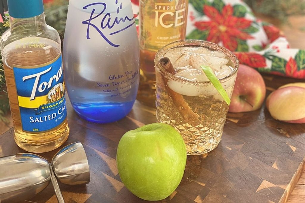 A holiday beverage next to some ingredients on a bar