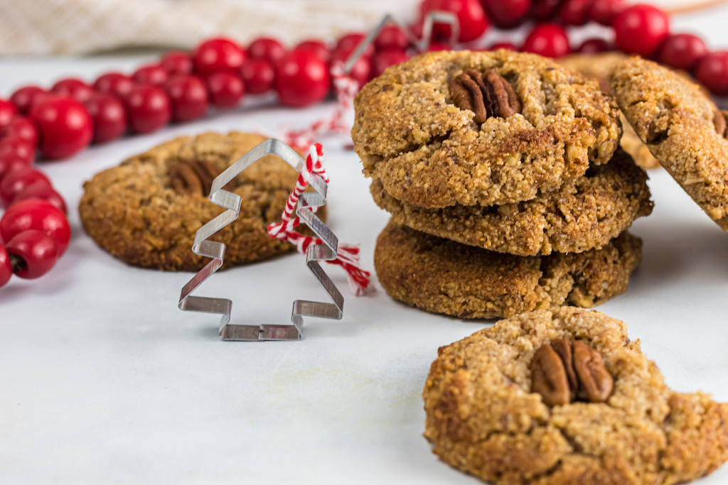 keto maple pecan cookies sitting on festive Christmas table