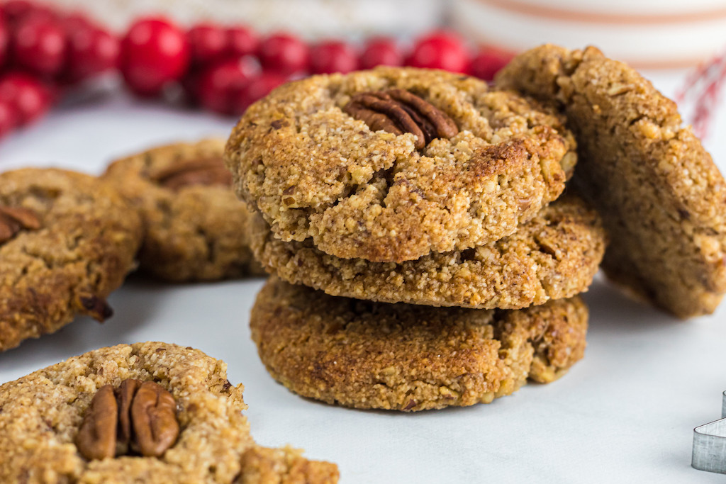 keto maple pecan cookies stacked up
