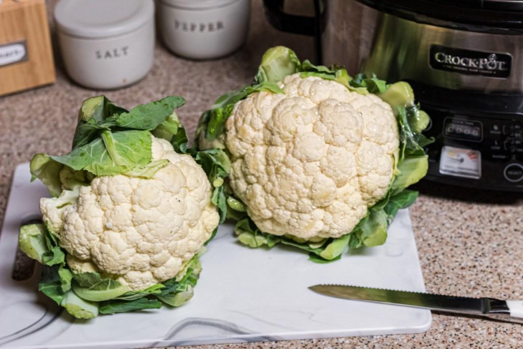 cauliflower heads on cutting board