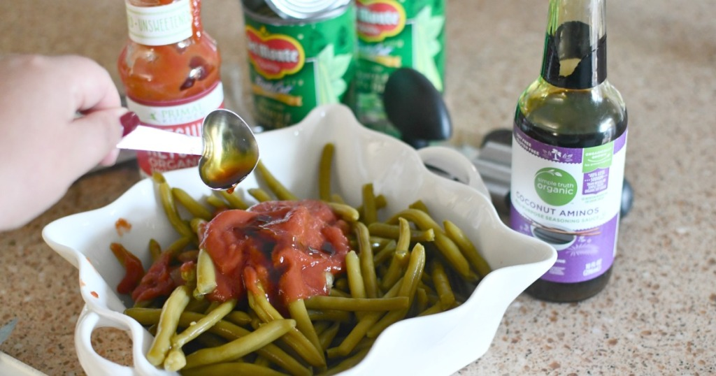 adding primal ketchup and coconut aminos to green beans