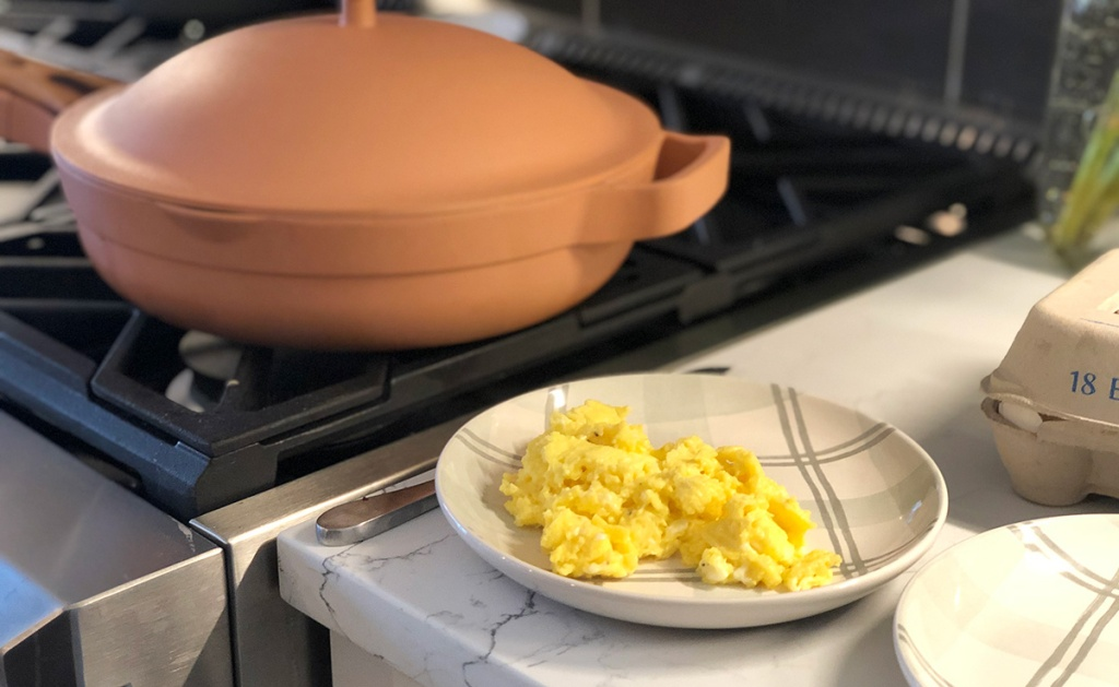 plate of scrambled eggs in front of always pan