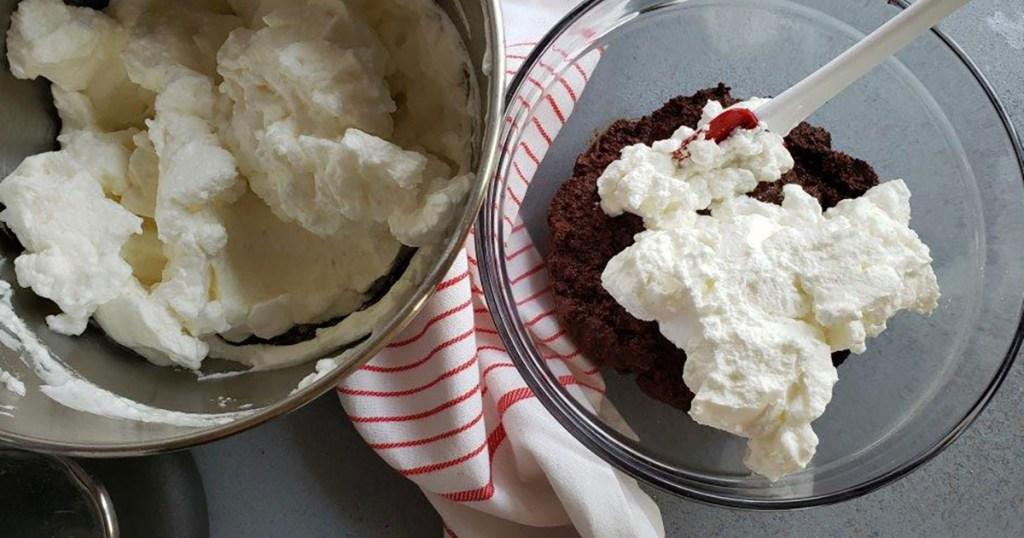 folding whipped egg whites into chocolate cake batter