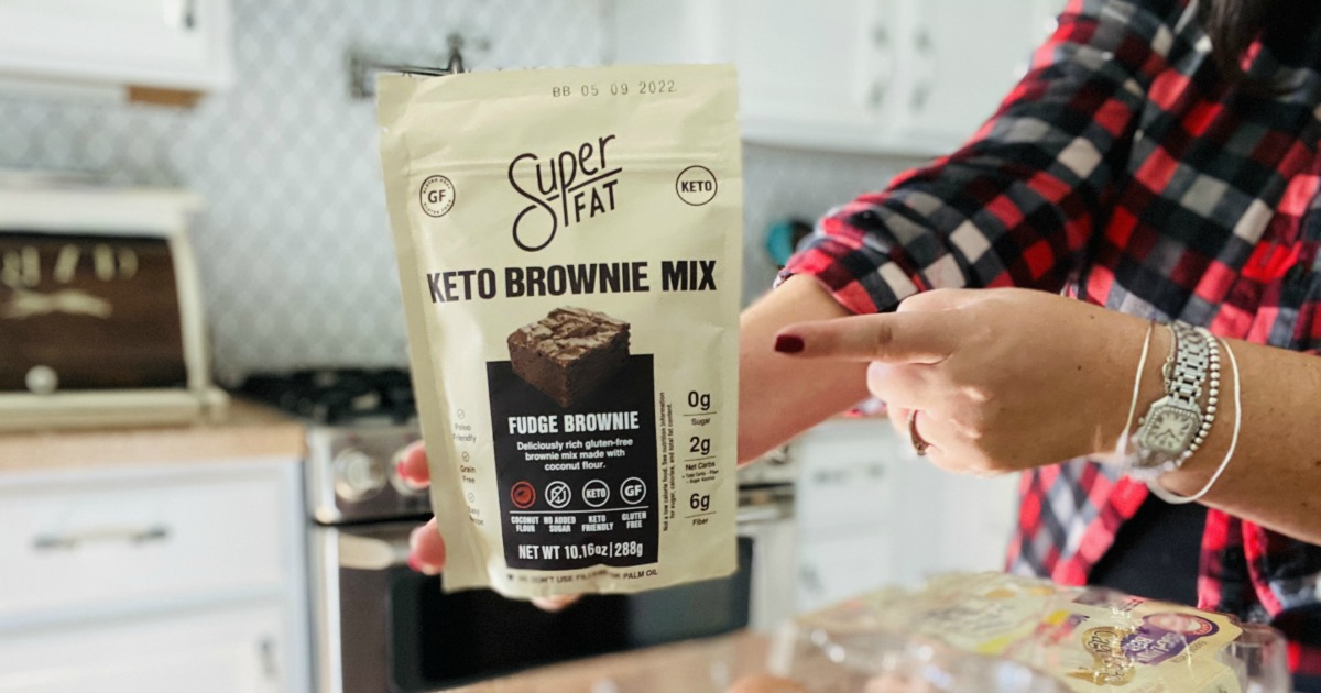 holding a package of Super Fat Brownie Mix