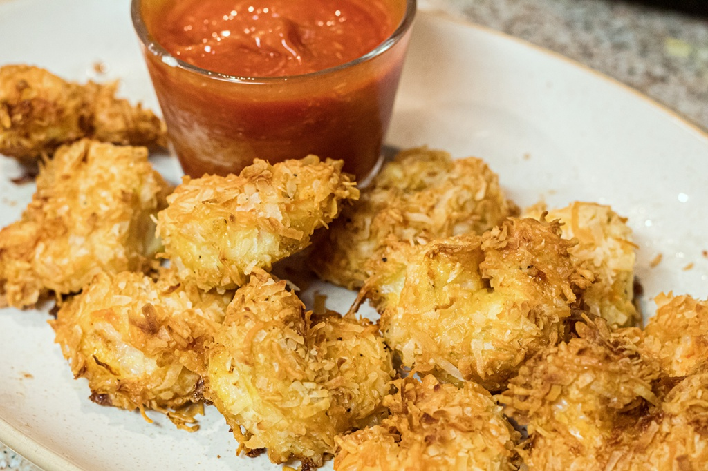 plate of keto coconut shrimp and cocktail sauce